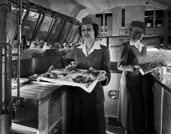 flight-attendants-used-to-prepare-pre-cooked-in-flight-meals-in-the-galley-working-at-a-rate-of-24-meals-in-18-minutes